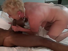 Granny sucking big black balls.
