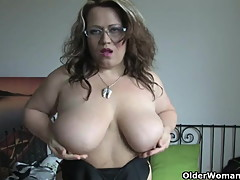 Chubby and busty mature housewife in black stockings