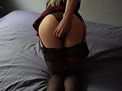 Girlfriend in cute outfit plays with her huge black dildo